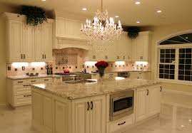 white kitchen cabinets with antique brown granite luxurious kitchen w antique white cabinetry
