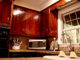 can you stain finished cabinets how to give your kitchen cabinets a makeover hgtv
