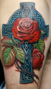 vivid colors celtic cross with red rose tattoo on half sleeve