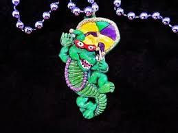 mardi gras umbrella glittered partying mardi gras gator mardi gras necklace bead