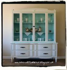 paint hutch and buffet paint inside of hutch or use fabric on