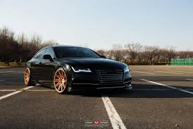 audi r8 gold sinister black audi rs7 with gold vossen wheels looks mean