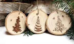 five wood burned christmas tree ornamentstree slice
