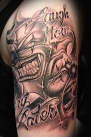 grey ink happy and sad clown mask tattoo design with quote