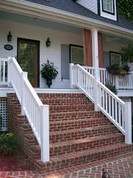 Large Front Porch House Plans Red Brick Steps Provide Contrast To The Bright White Home Exterior