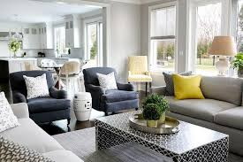 dark gray coffee table gray sofa with bright yellow pillows and black waterfall coffee