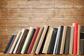 old books on a wooden shelf no labels blank spine stock photo