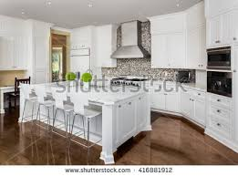 kitchen island sink cabinets hardwood floors stock photo 315797645