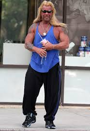 dog the bounty hunter and his buxom wife beth chapman head to a
