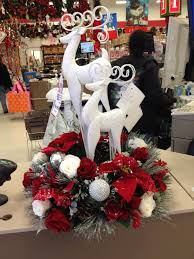 silver deer with red poinsettias and roses and white roses my