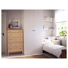 a pax white wardrobe with ballstad white doors and malm chest of