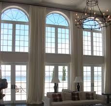 calming tall white drapery arch window shade in shady beach themed