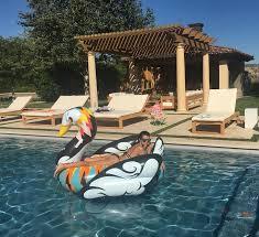 Kourtney Kardashian New Home Decor by Kourtney Kardashian Relaxes On A Swan Float In A Teeny Black