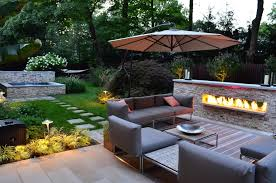 glorious grey colored outdoor sofa combined with stone fireplace