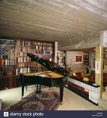 grand piano in eighties country living room with bookshelves and
