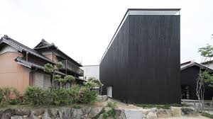 Katsutoshi Sasakis minimalist home has a dark exterior and a light