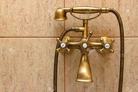old fashioned bathtub faucets vintage bathtub faucet and ceramic tiles in background retro stock
