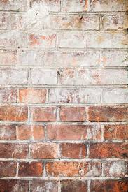 background texture the wall of the old red brick splashed with