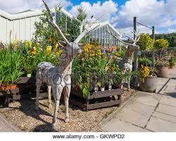 a size wooden deer garden ornament in the garden centre at