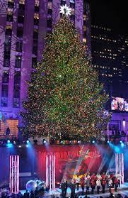 behold rockefeller center tree lights up the