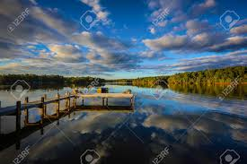 a beautiful southern sunset reflecting on a calm lake in the