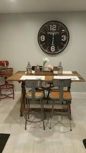 best 25 industrial placemats ideas on pinterest wooden big clock from hobby lobby vintage drafting table with mismatched industrial stools antique tool box with old milk bottles and flowers cotton placemats