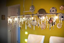 Dining Room Crystal Chandeliers Linear Crystal Chandelier And Acid Green Wall Of Plates Eclectic