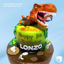 dinosaur cakes fierce raptor dinosaur cake and dinosaur cupcakes the regali kitchen