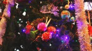 bright christmas toys balls and bells on the christmas tree
