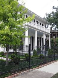 luxury iron fence landscape traditional with front yard