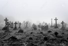 white and black halloween background spooky foggy ancient cemetery halloween background stock photo