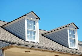 modern grey house roof dormer windows that has minimalist white