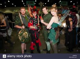 cosplayers dressed peter pan rufio tinkerbell
