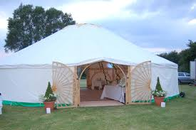 hand cut decorative wooden frame forming arches to this circular