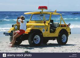 yellow jeep lifeguard and yellow jeep at laguna beach in southern california