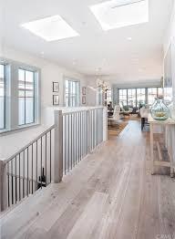 cottage hallway with walnut s white engineered hardwood plank high ceiling hardwood floors