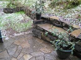 Bench Built Into Wall Stone Bench In Drystack Wall Cedar Sustainable Woodwork