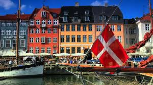 static shot of old buildings with danish flag in the foreground in