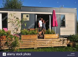 a couple on vacation in a luxury contemporary design mobile home