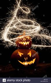 halloween pumpkin jack o lantern fire face and fireworks stock