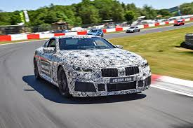 bmw car race bmw is already developing an m8 and they re going to race it at le