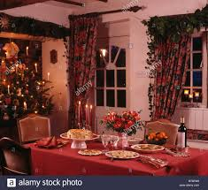 Cottage Dining Room Sets by Red Cloth On Table Set For Christmas Tea In Cottage Dining Room