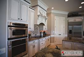 bright white kitchen cabinets with chocolate glaze to accent the