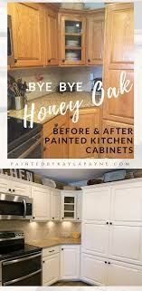 painting stained wood kitchen cabinets bye bye honey oak kitchen cabinets hello brighter kitchen