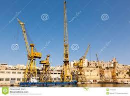 port cargo crane in shipyards harbor of malta stock photography