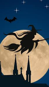 halloween witch flying broom over moon
