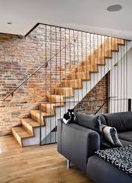 renovated 1890s brooklyn home with brick walls by gradient design view in gallery staircase offers a blend of contrasting textures and materials