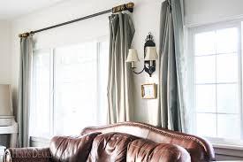 farmhouse drop cloth curtains she holds dearly