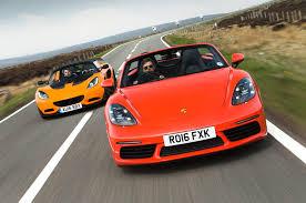 porsche cayman s vs boxster s porsche 718 boxster s vs lotus elise sports cars compared autocar