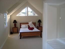 attic ideas brown wooden nightstand near white window attic bedroom ideas for